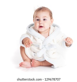 Baby in a bathrobe after bath with wet head
