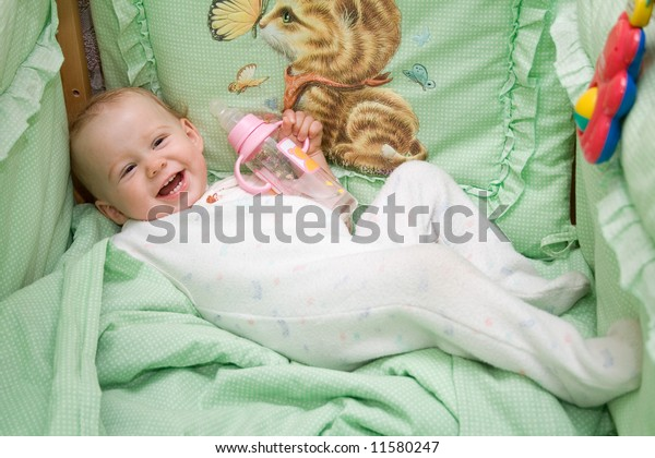 baby in the bed