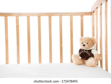 Baby bed with teddy bear for child on a white background