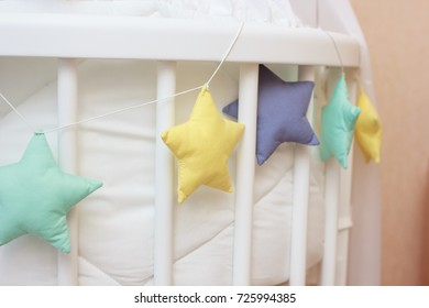 baby bed with toys closeup