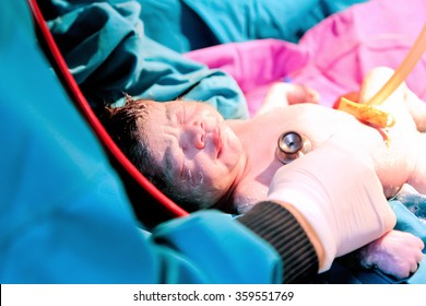Baby being born or baby  minutes after the birth.warm tone