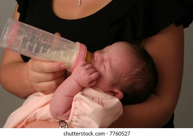 baby being fed milk