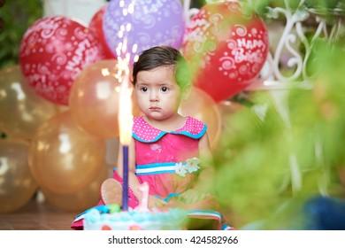 baby with birthday cake celebrating one year