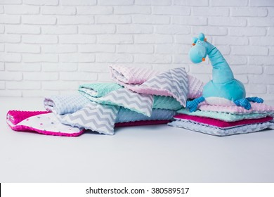 baby blankets and soft toy on white background