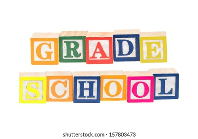 Baby blocks spelling grade school. Isolated on a white background.