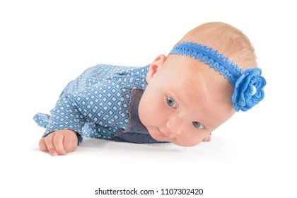 baby in blue lying on stomach