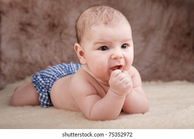 Baby in blue pants