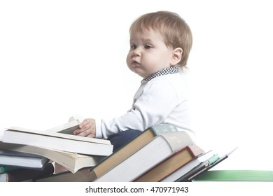 baby with books isolated on white
