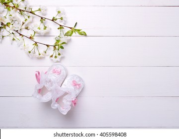 baby booties with flowers on a white background