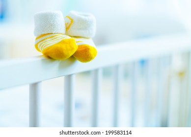 baby booties on a cot