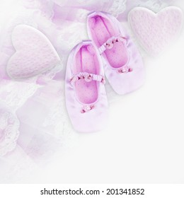 Baby booties on lace background.
