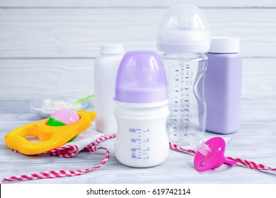 baby bottle with milk on wooden background