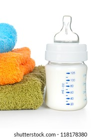 Baby bottle and towels on a white background