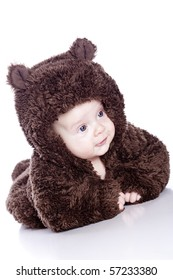 Baby boy in a bear suit on white background