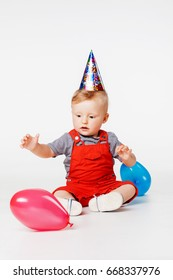 Baby Boy With Birthday Hat And Balloons