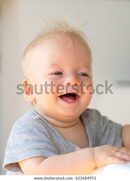 Baby boy with blue eyes portrait
