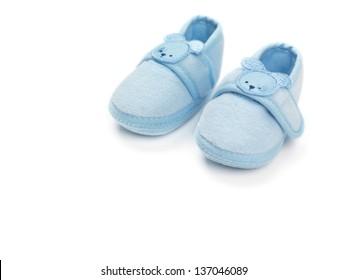 Baby boy blue shoes isolated on white background