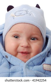 Baby boy in blue winter clothes isolated