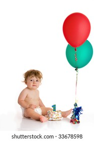 baby boy with cake and balloons