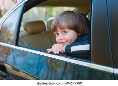 Baby boy in the car.
