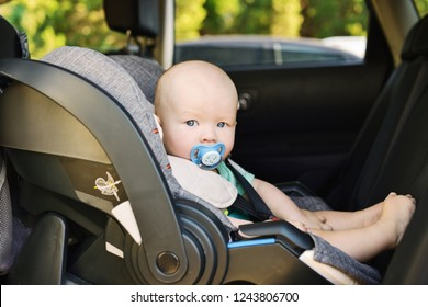 baby boy in the car seat in summer