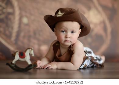 baby boy in cowboy costume