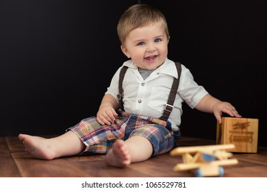 Baby boy with the cutest smile on his face while he is playing with his blocks.