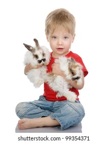 baby boy with easter rabbits. isolated on white background