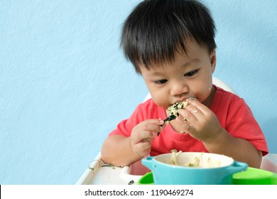 Baby boy eat by himself as Baby-led weaning
