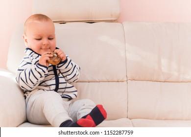 Baby boy eating cake