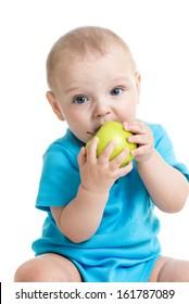 baby boy eating green apple