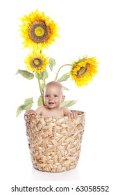 Baby boy with flowers on white background