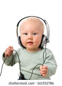 Baby boy with headphones, isolated