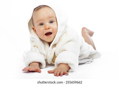 baby boy  is hiding under the blanket