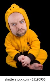 Baby boy with a man's face in a bumble bee costume isolated over a black background
