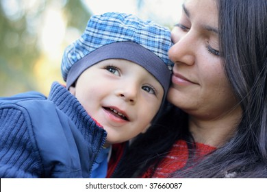 Baby boy with mother play in park