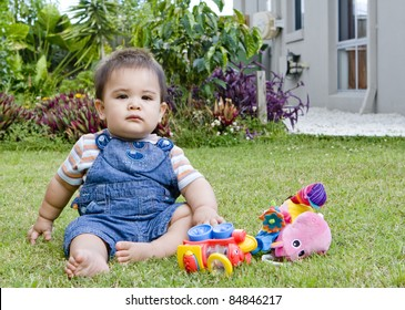 a baby boy in a natural setting in a garden