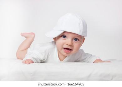 Baby boy on white background  smiling