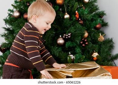 Baby boy opening a christmas-box