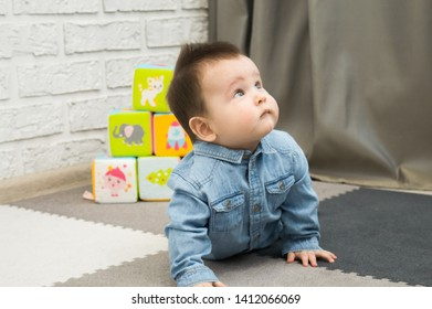 baby boy plaing in babyroom