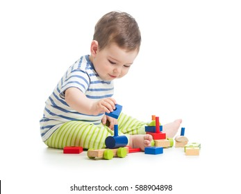 Baby boy playing with blocks toys isolated on white background