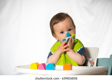 Baby boy playing with chewing toy. (9-month-old).