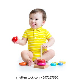 baby boy playing with colorful toy pyramid isolated