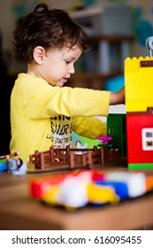 Baby boy playing with construction toy blocks at home. Kids playing. Children at day care. Child and toys