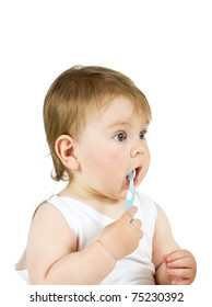 Baby boy playing with a new toothbrush. Isolated on white.