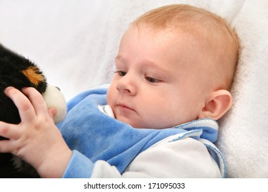 Baby Boy Playing with a Toy Closeup