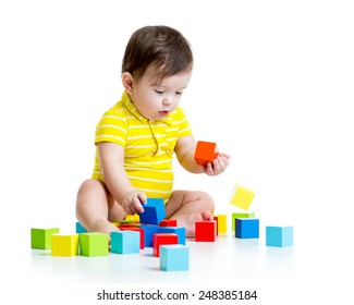baby boy playing with wood toys isolated