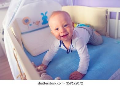 baby boy posing in his bed