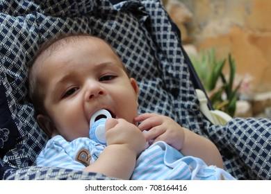 baby boy in pushchair