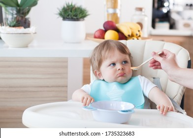 Baby boy refuses to eat puree.